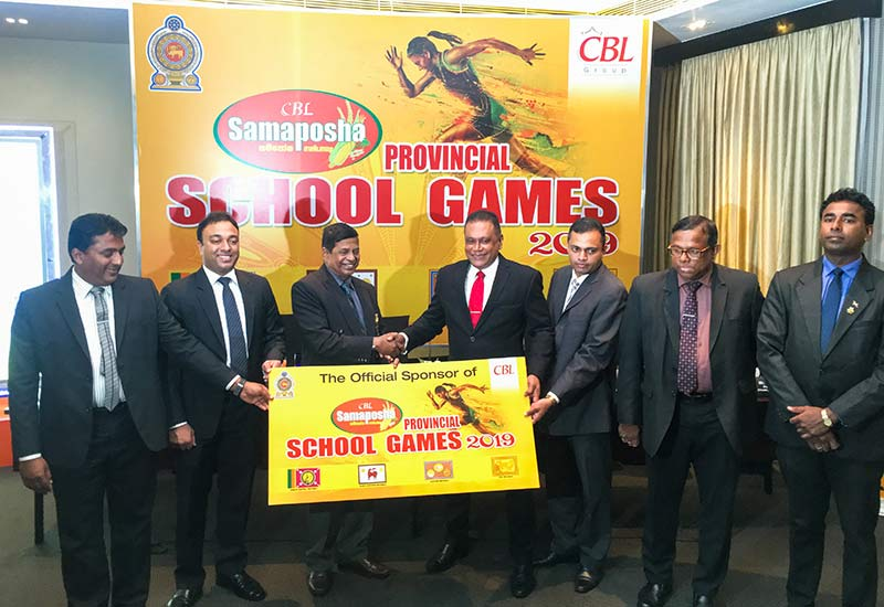 Shammi Karunaratne, Director/CEO (CBL Plenty Foods) together with Jayanga Perera, General Manager Marketing (CBL Food Cluster) hands over the Samaposha sponsorship for the Samaposha Provincial School Games 2019 to the Provincial Education Officers; H.G. Channa Karunasena, Assistant Director of Education (Physical Education & Sports - Uva Province), E.G.P.I. Dharmathilake, Assistant Director of Education (Physical Education & Sports - Eastern Province), H.K.M. Rajathilake, Deputy Director Education (Physical Education & Sports - North Western Province), Y.M.H.K. Abeykoon, Assistant Director of Education (Health, Physical Education & Sports - North Central Province) and Sunil Jayaweera, Special adviser for Minister of Education.