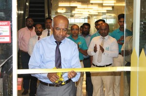St. Anthony's Hardware Chairman, Mr. S.R. Gnanam ceremoniously opens the 'HOMEMART mini' at Orion City.