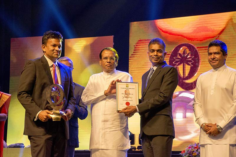 The National Quality Award 2018 for Large Scale Manufacturing was presented by His Excellency President Maithripala Sirisena. Asitha Samaraweera, Managing Director (Left) along with Viraj Jayasooriya, Director/COO Operations (Right) from Atlas Axillia accepted the award. State Minister for International Trade, Sujeewa Serasinghe looks on.