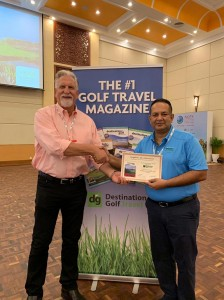 "Mr. Asela Wavita, General Manager of The Victoria Golf & Country Resort, being presented the certificate for the ""Most Memorable Golf Course in Asia 2019"" by Mr. Sam Sokocius, Member of the Panel of Judges and Golf Travel Writer of Destination Golf."