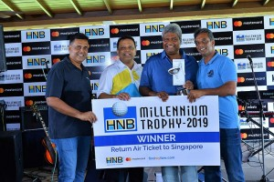 Jonathan Alles Managing Director / CEO HNB, handing over the overall champions' trophy to Damith Wickramasinghe, Sanjay Wijemanne, Deputy General Manager, Retail Banking, HNB and Sanjiv Vairavanthan, President RCGC is also in the picture