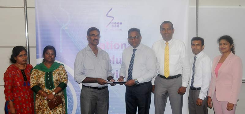 Participants at the agreement signing, from left to right include: Ms. Theresha Malar Gopal / Account Assistant (Rasika Holdings), Ms. Kayattiri Edirisinghe / Account Assistant (Rasika Holdings), Mr. R. Kailayapillai / Chairman (Rasika Holdings),  Mr. Kiththi Perera / Chief Executive Officer (SLT), Mr. Chethana Attanayake / General Manager Western Province Central (SLT), Mr. Kelum Priyantha / Manager Business Development (SLT), Ms. Chithra Kumari / Senior Executive Assistant Manager (SLT).