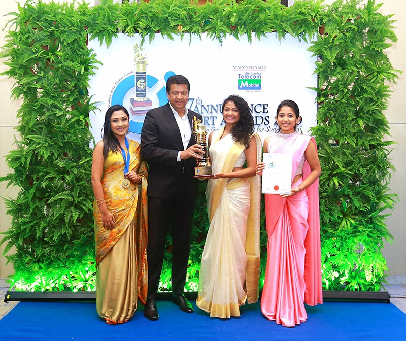 Associate Technical Lead Helani Wanniarachchi, CEO Mano Sekaram, Technical Lead Charindra Wijemanne and Software Engineer Pramitha Samarakoon with the Gold Award in the ICT/BPO sector