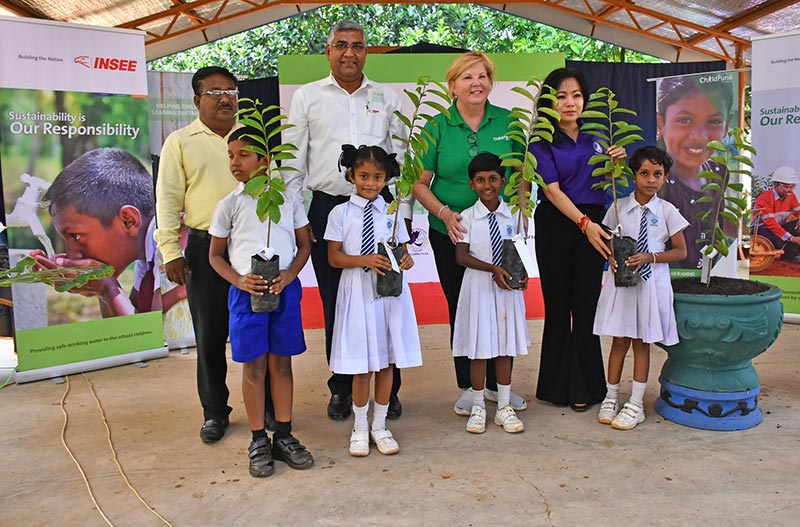 Left to Right :  Mr. H. M. N. Janaka Senevirathne, Vice Principal of Kannangara Primary Model school, Anamaduwa Puttalam; Mr. Nandana Ekanayake, Chairman/CEO of INSEE Cement Sri Lanka; Ms. Katherine Manik, Country Director of Child Fund Sri Lanka; H.E Ambassador Dr. Phan Kieu Thu, Secretary General of Colombo Plan with school children from beneficiary schools.