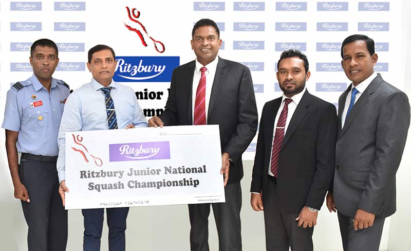 Presenting the sponsorship of the '30th Ritzbury Junior National Squash Championship' is Nilupul de Silva, General Manager, Marketing, CBL Foods International (Pvt) Ltd (center right) to Ajith Abeysekera Air Commodore (Rtd), President of Sri Lanka Squash (center left). Also pictured are officials from CBL and Sri Lanka Squash Federation.