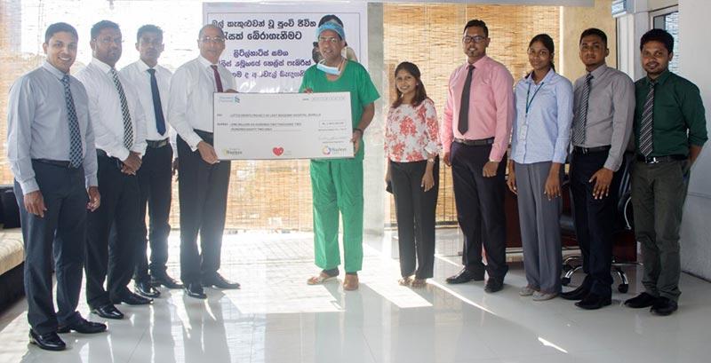 Hayleys Fabric PLC Managing Director Rohan Goonetilleke hand over a donation of Rs. 1.6 million to Consultant Paediatric Cardiologist of the Lady Ridgeway Hospital Dr. Duminda Samarasinghe.