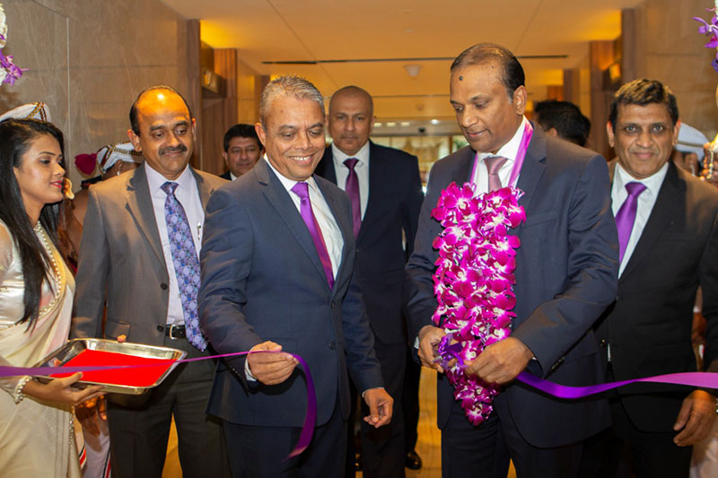 From left: Softlogic Life Managing Director Iftikar Ahamed, Softlogic Group Chairman Ashok Pathirage and Softlogic Life Executive Director Chula Hettiarachchi cutting the ceremonial ribbon to unveil Softlogic Life's new office