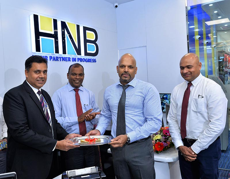 Sanjay Wijemanne, Deputy General Manager, Retail Banking, HNB accepting the first deposit from Milinda Wickramaratna, Jude Fernando, Deputy General Manager, SME & Midmarket, HNB, and Robin Perera, Manager– Dematagoda, HNB Customer Centre are also in the picture.