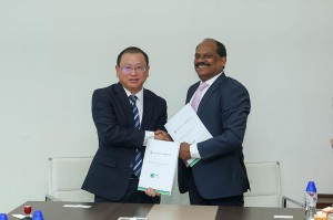 CHEC Port City Colombo (Pvt) Ltd Managing Director Jiang Houliang exchange the MoU with NSBM Green University Town Vice Chancellor Prof. E. A. Weerasinghe