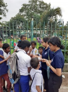 Volunteers deployed in Slave Island educating school children on the importance of reporting violence while distributing information cards