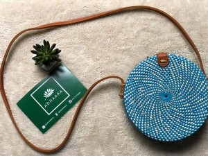 Handcrafted rattan bags by Adhaara use ethically sourced ata grass and upcycled batik
