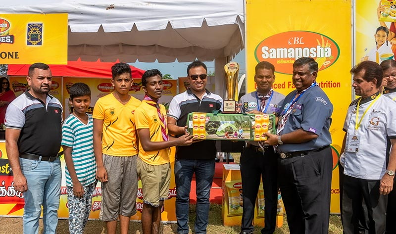 The gold trophy and gifts being awarded to the scouts of Al-Hidaya National, by Jayanga Perera, General Manager, Marketing, CBL Food Cluster and the District Commissioner of the Colombo District Scout Association, Suren Wikkramatilleke