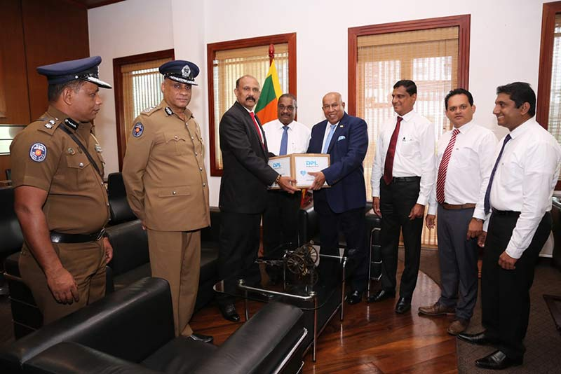 Defence Secrtary, Maj. Gen (Retd) Kamal Gunaratne, Hayleys Group Security Manager, Hemantha Adhikari and Hayleys PLC Chairman and Chief Executive, Mohan Pandithage with the Dipped Products team.