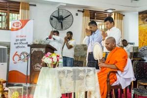 Venerable Thibbatuwawe Buddharakkitha Thero the Nayake Thero of the Ridi Viharaya, and Member of the Kaaraka Sangha Sabha of the Malwatu Chapter preaching, with Atlas mangement's presence.