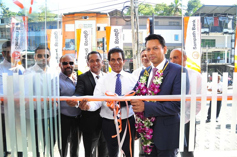 The picture shows Rushanka Silva - Non Executive Director, Sampath Bank PLC along with Indra Silva – Chairman, Indra Group and Nanda Fernando - Managing Director, Sampath Bank PLC, ceremonially opening the newly relocated off-site ATM at Katugastota.