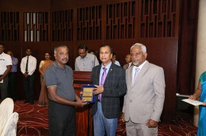 M. Victor Pushpasiri receiving the BMICH Employee of the Year 2019 Award from Sunil Dissanayake - Director/Chief Executive, BMICH