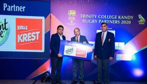 Nadina Fernando, Trade Marketing Manager of Elephant House Beverages presenting the sponsorship to Dr. Nalin Wickremanayake, Principal of Trinity College.  Channa Pathirana, Chairman of Old Trinitians Rugby Scrummage is also in the picture.