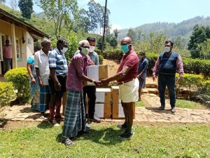 Issuing dry rations to elderly people in the estate