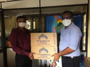 Handing over the consignment of Pelwatte Milk Powder to Mithuru Mithuro  Repre-sentative
