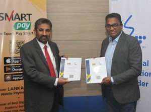 General Manager of BOC, Mr. Sugath Gunasekara (left) and Chief Executive Officer of SLT, Mr. Kiththi Perera exchanging the Agreement between SLT and Bank of Ceylon.