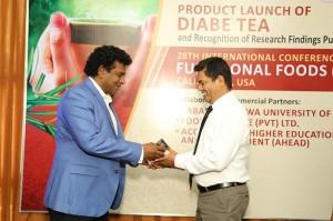 Mr.Chamendra Somathunge,Managing Director, FADNA Tea Pvt Ltd handing over the improved 'diabe tea' new formulation developed by SUSL to Prof. Udaya Rathanayake, Dean, Faculty of Applied Sciences, Sabaragamuwa University of Sri Lanka.