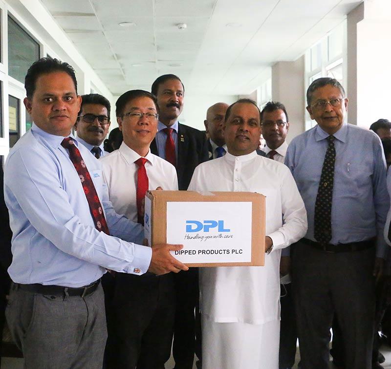 DPL Deputy Managing Director, Pushpika Janadheera handing over a box of gloves to Minister of Environment, Mahinda Amaraweera at the Central Environmental Authority.