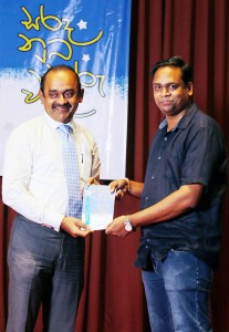"""1. Supun Athukorala presenting his latest collection of poems in """"Sarada Nuba Tharu Wela"""" to the Chief Guest of the launch ceremony Sujeewa Rajapakse – Chairman of People's Bank"""
