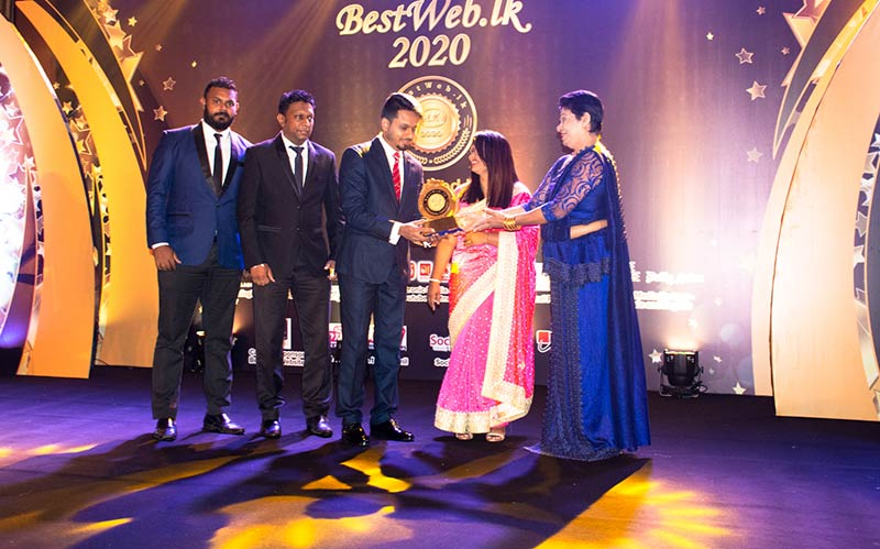 Accepting the Gold award for the 'Best Corporate Website in Sri Lanka' by Dineth Silva, Manager – Digital Media, Dushantha Rangana – Assistant General Manager, and Ruminda Randeniya – Director of Prime Group. (From left to right)