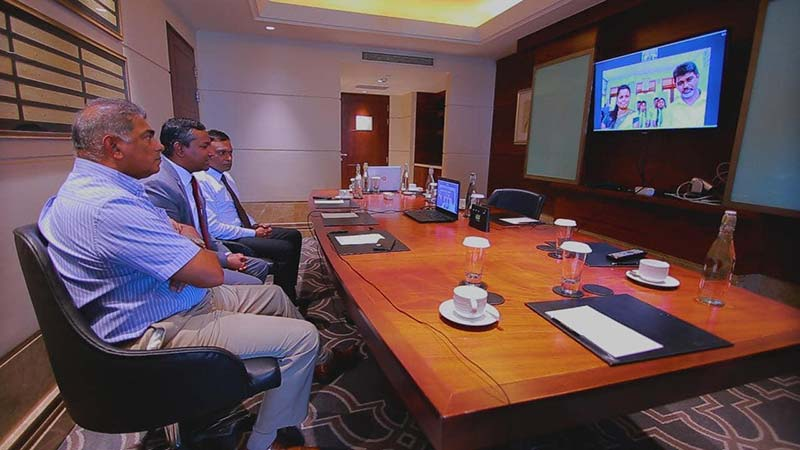 Mr. Rohan Fernando, Chairman of SLT Group, Mr. Oshada Senanayake, Director General of TRCSL, Mr. Lalith Seneviratne, Group CEO of SLT & Mobitel engaging in a live video conferencing with Mr. M.A Sumith Lal, Principal of the Lankagama School and Mrs. Iresha Wikramasinghe, IT Teacher.