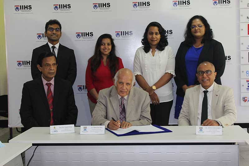 Dr.Nihal De Silva (centre), Chairman/ Co-Founder , IIHS signing the agreement. Also pictured, Eng. Lionel Pinto (left), Chairman, Skills Development Fund Ltd and Dr.Kithsiri Edirisinghe (right), CEO/Co-Founder IIHS, together with board of directors from the IIHS with some members of higher management, IIHS