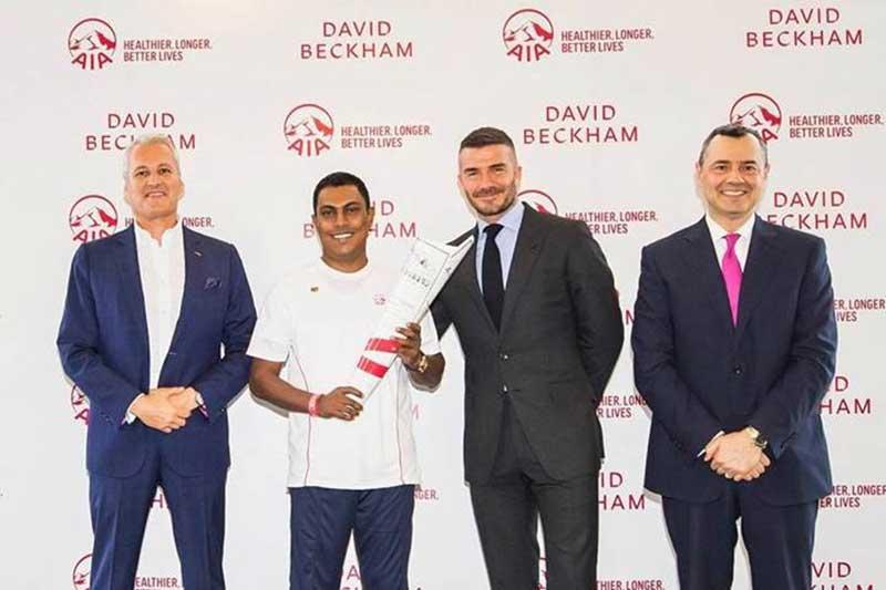 AIA Sri Lanka Wealth Planner Krishan Dassanayaka with AIA's Global Brand Ambassador David Beckham and AIA Group CMO Stuart Spencer at the AIA Centennial Celebrations 2019.