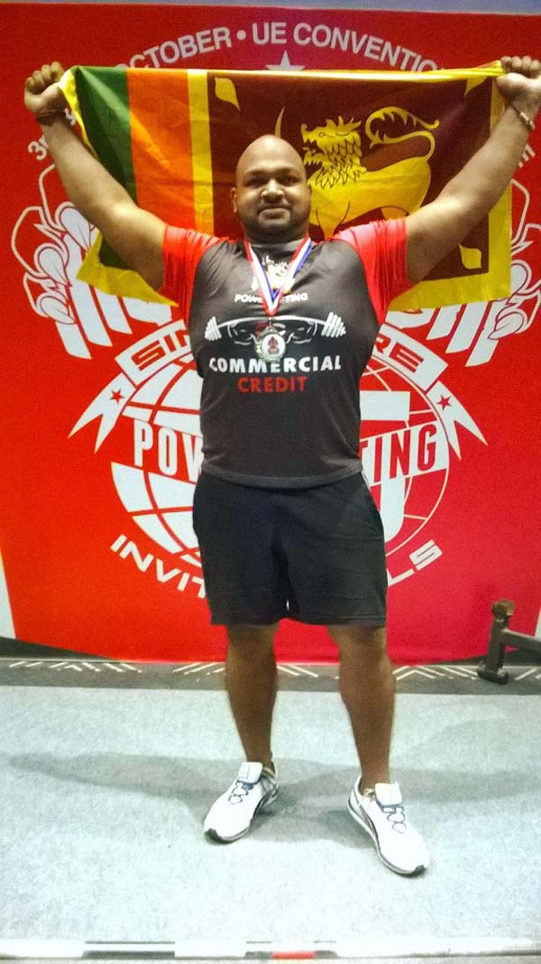 PHOTO – Weight lifter Ransilu brings home the Gold