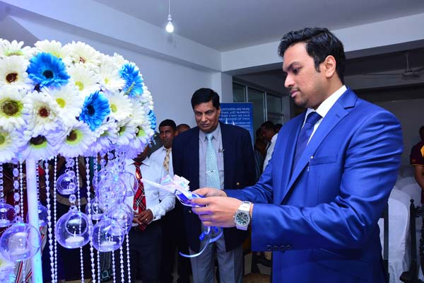 Dr. Hiran Hettiarachchi (MBBS-Colombo, MBA – Australia) – Group Chairman, Blue Mountain Group of Companies lights a ceremonial lamp to declare the branch open