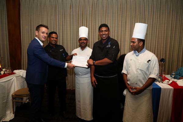 The Award-Winning Waters Edge Culinary Team receiving accolades from Jean-Philippe Gavois