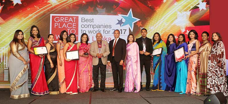 Chairman-and-Managing-Director-DIMO-Ranjith-Pandithage-with-the-team-at-the-Great-Place-to-Work-awards-ceremony.