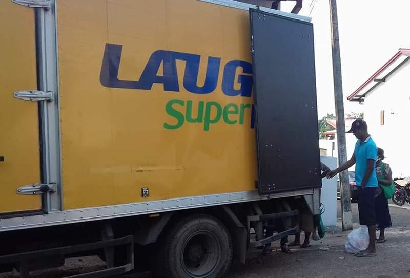 LAUGFS-Supermarkets-door-to-door-service-lorries-distributing-goods
